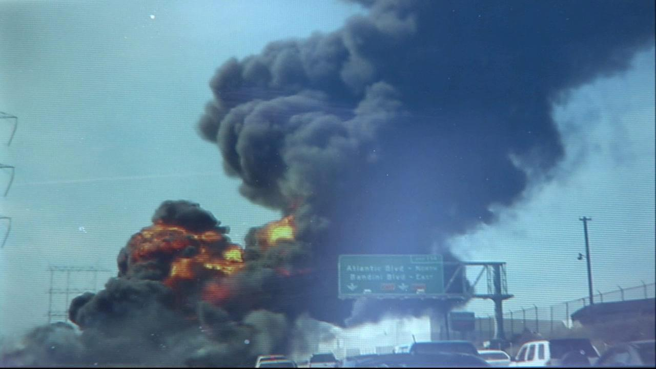 Thick smoke rises from the scene where a tanker truck exploded on the 710 Freeway in the city of Bell on Sunday, April 26, 2015.