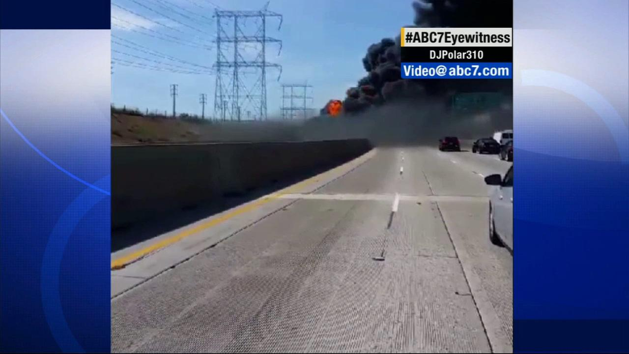 Thick smoke rises from the scene where a tanker truck exploded on the 710 Freeway in the city of Bell on Sunday, April 26, 2015.ABC7 viewer