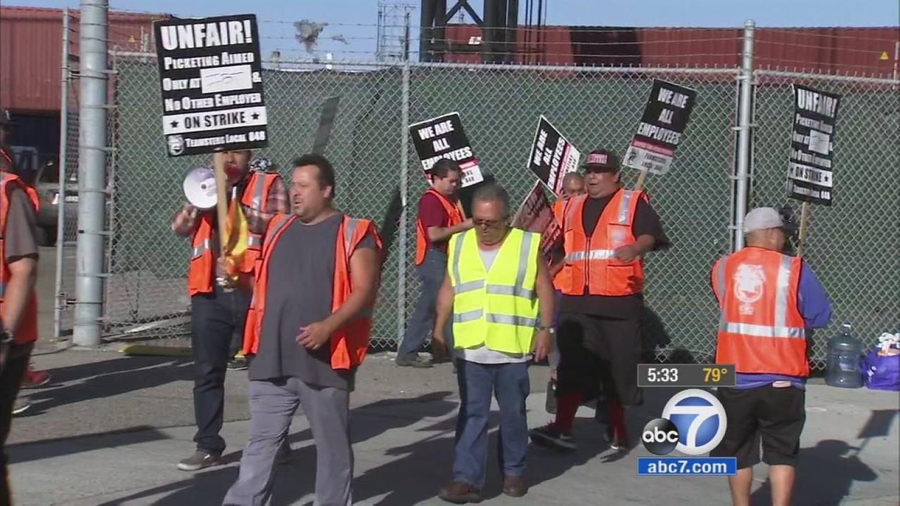 Truck drivers at Los Angeles and Long Beach ports walked off the job on Monday, April 27, 2015 over a dispute over wages and employee status.