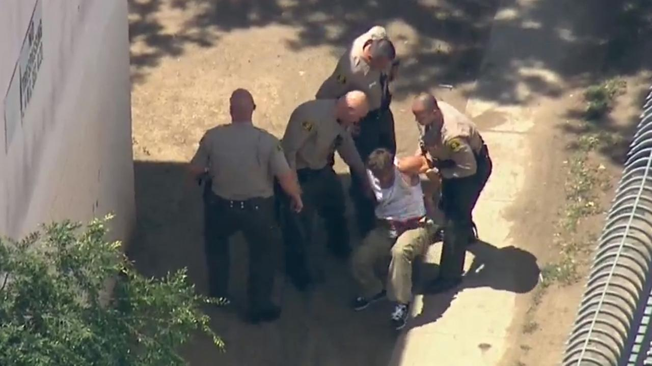An alleged narcotics suspect was taken into custody by sheriffs deputies near 103rd and Grape streets in Watts Thursday, April 30, 2015.