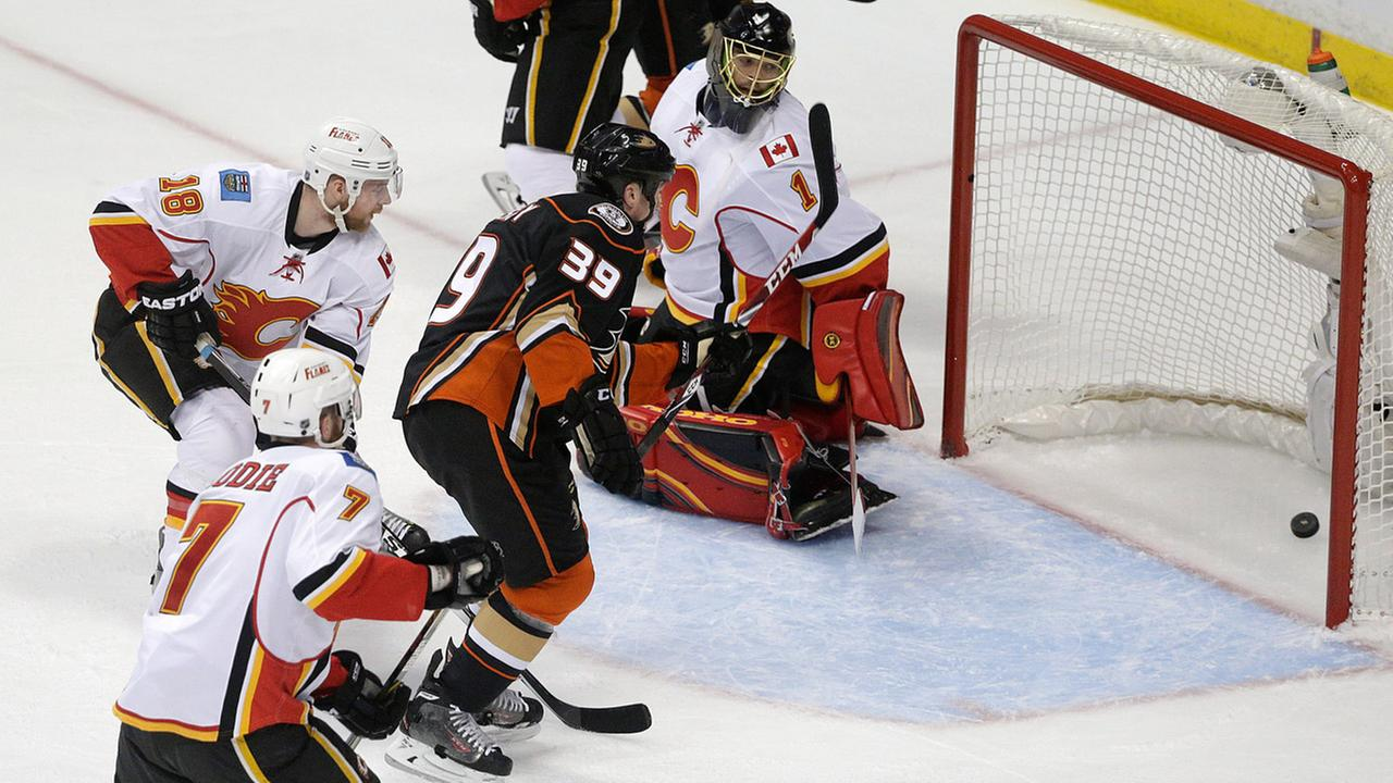 Anaheim Ducks Matt Beleskey hits a shot past Calgary Flames goalie Jonas Hiller in Game 1 in the second round of the NHL Stanley Cup Playoffs, Thursday, April 30, 2015.