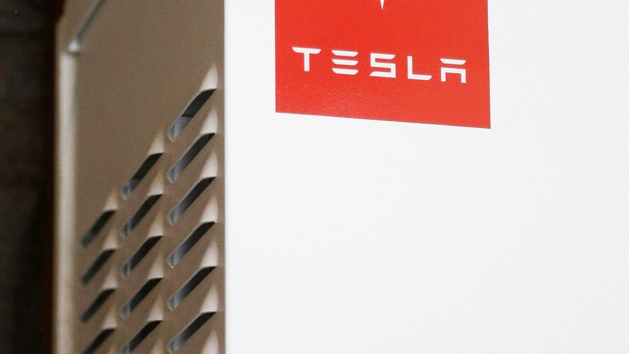 This April 20, 2015 photo shows a prototype Tesla battery system that powers the home of David Cunningham in Foster City, Calif.