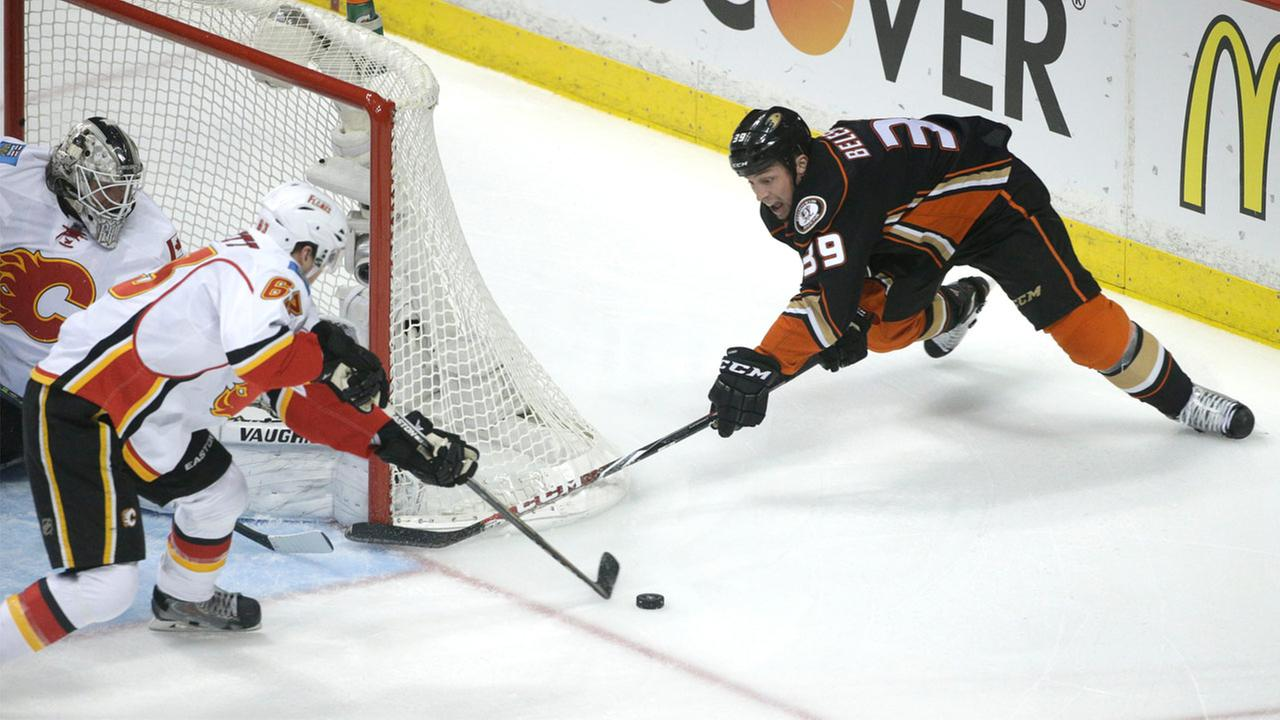 Anaheim Ducks Matt Beleskey is defended by Calgary Flames Sam Bennett during Game 2 in the second round of the NHL Stanley Cup hockey playoffs, Sunday, May 3, 2015.