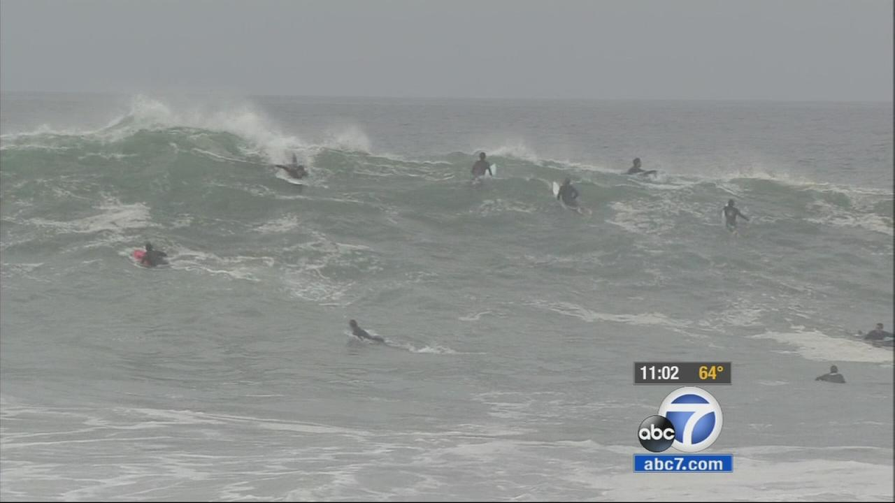 Newport Beach lifeguards enforced blackball rules Monday to keep surfboards from colliding with swimmers amid high surf conditions.