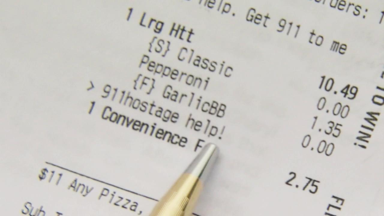 A receipt shows a help message written by a Florida woman who was allegedly being held hostage.