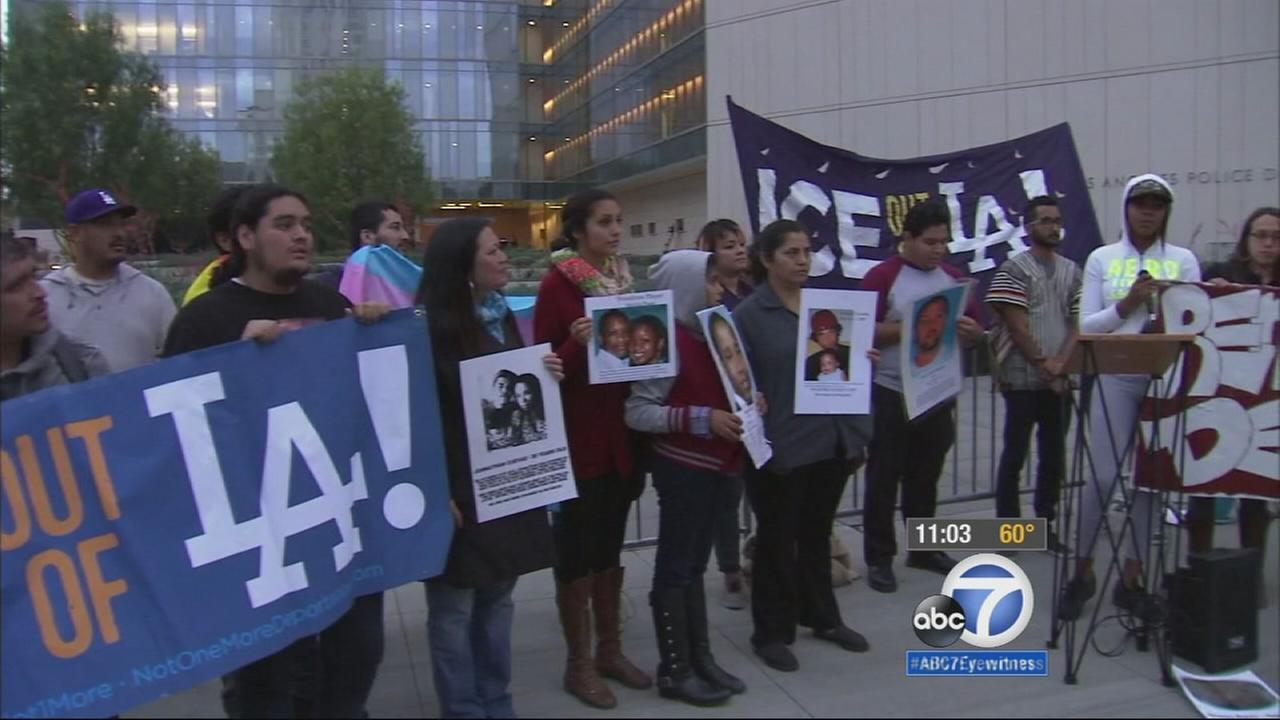 There was a new protest over officer-involved shootings Friday, May 8, 2015, as dozens of people gathered outside LAPD headquarters in downtown Los Angeles.