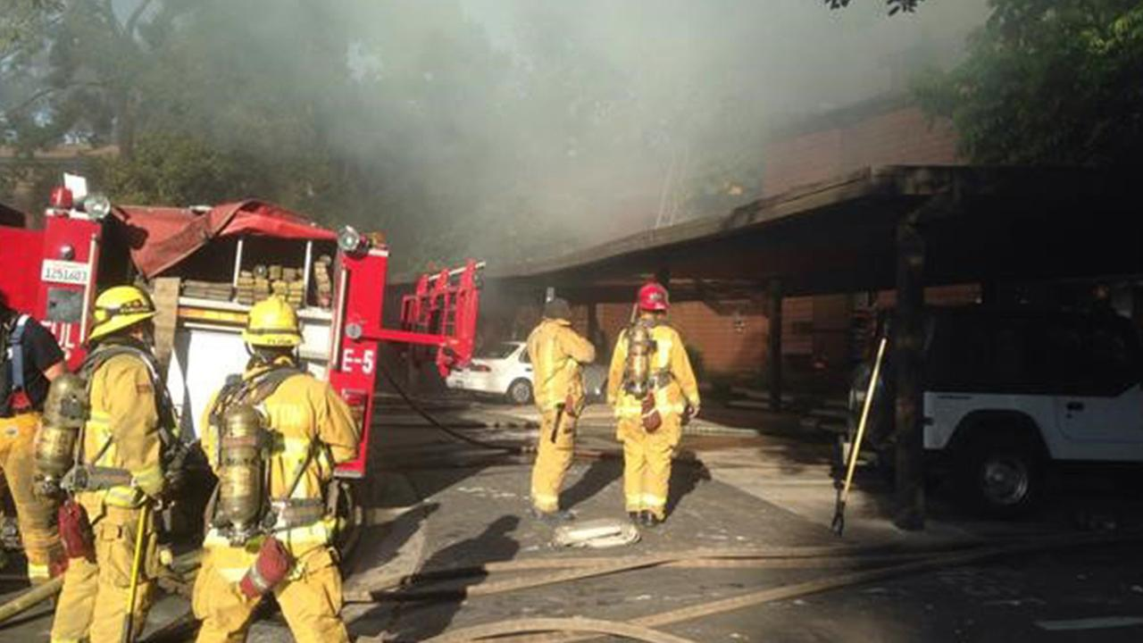 Firefighters were responding to a third-alarm house fire in Fullerton on Sunday, May 10, 2015.