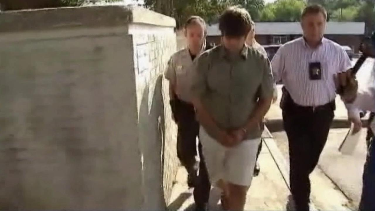 Jared Workman, 27, walks with deputies while they escort him to jail in this undated file photo.