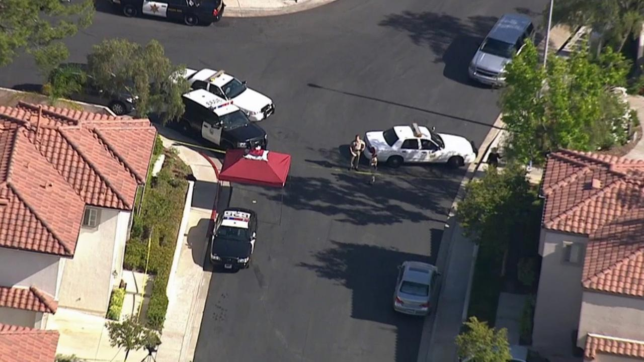 Orange County sheriffs deputies investigate a fatal deputy-involved shooting near Paseo Viento and Melinda Road in Rancho Santa Margarita Tuesday, May 12, 2015.