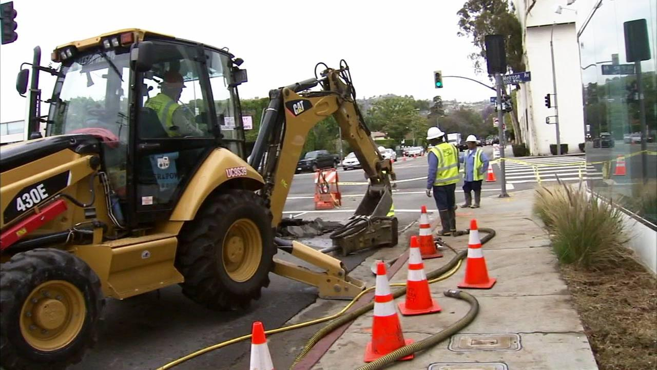 Crews work to repair a broken water main in the Fairfax Village area on Wednesday, May 13, 2015.