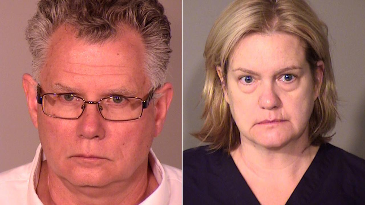 Paul McQuillan (L) and his wife, Dr. Ellen Crowe (R), are seen in these booking photos.