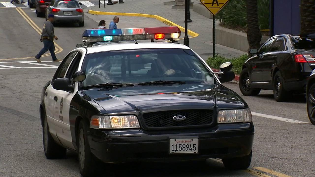 A Los Angeles Police Department cruiser arrives at the Burbank Town Center in pursuit of a kidnapping suspect on Friday, May 15, 2015.