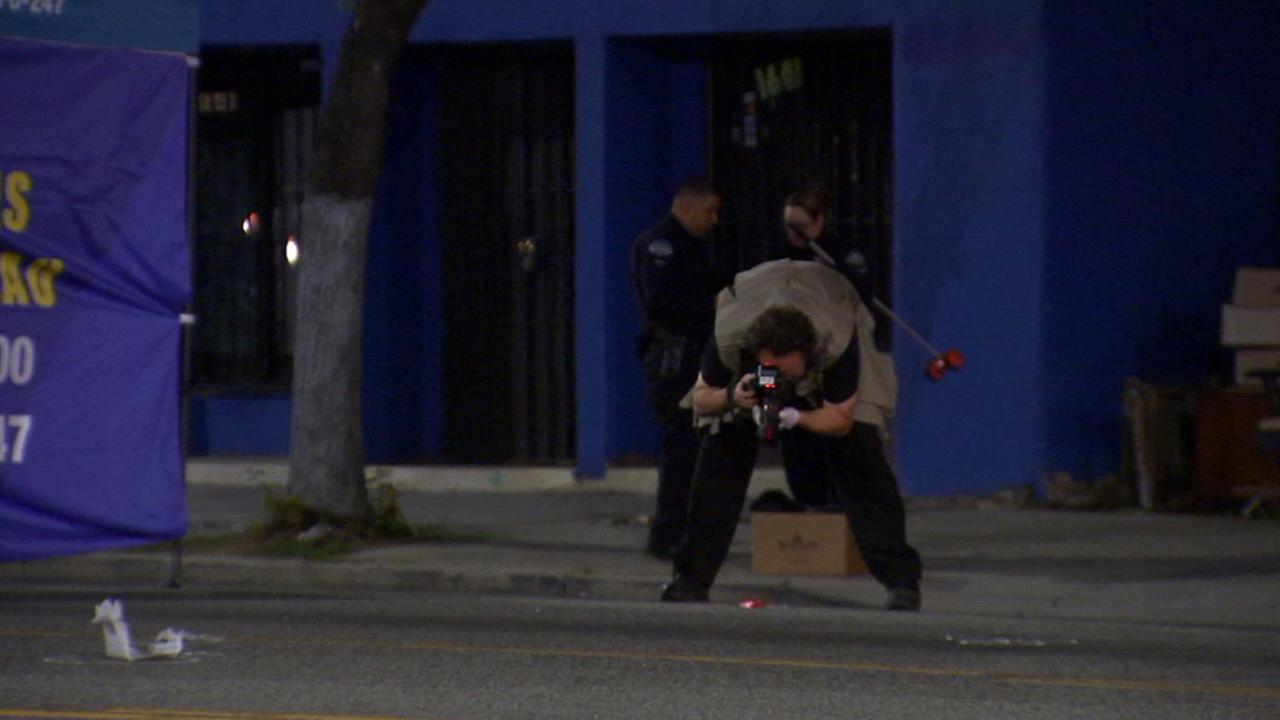 Los Angeles police officers respond to a fatal hit-and-run in the 1600 block of West Florence Avenue in South Los Angeles Saturday, May 16, 2015.