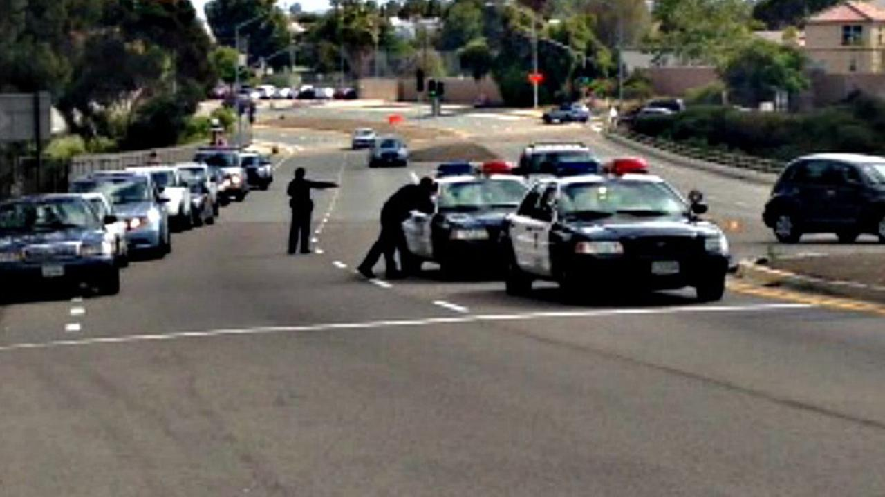 San Diego police officers investigate a fatal officer-involved shooting following a high-speed chase Sunday, May 17, 2015.