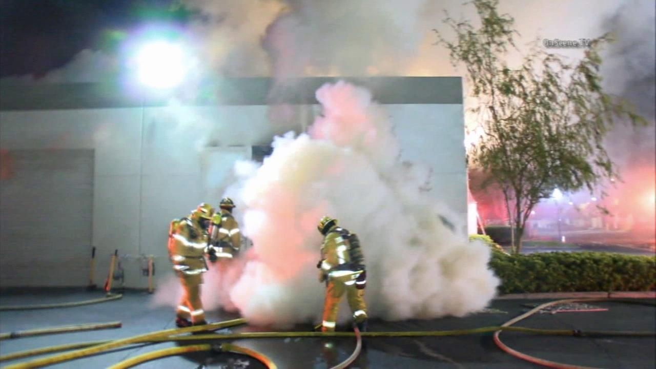 Firefighters in Anaheim faced a frightening backdraft situation while batting a fire at a wedding planning on Monday, May 18, 2015.