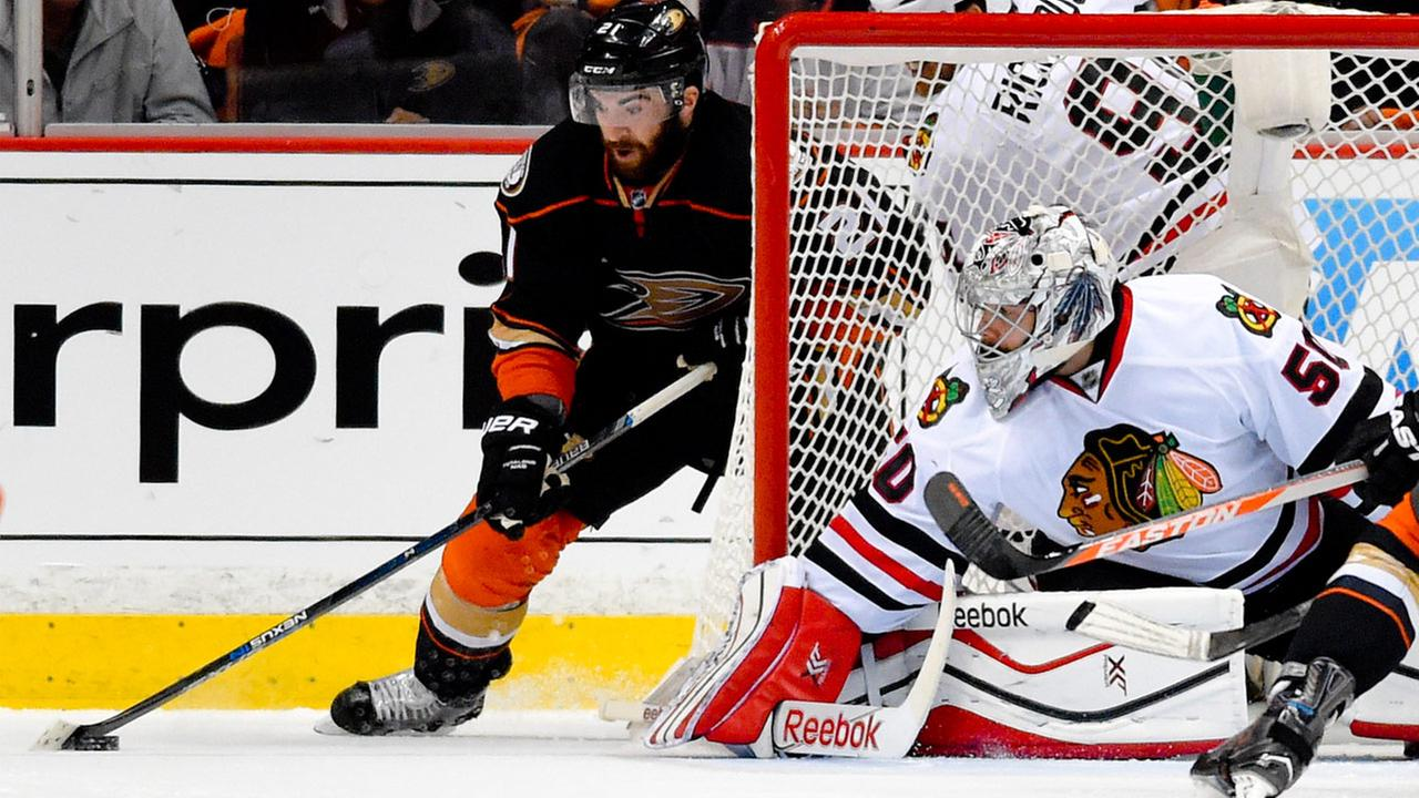Anaheim Ducks Kyle Palmieri, left, prepares to shoot against Chicago Blackhawks goalie Corey Crawford in Game 2 of the west final during the NHL playoffs on Tuesday, May 19, 2015.