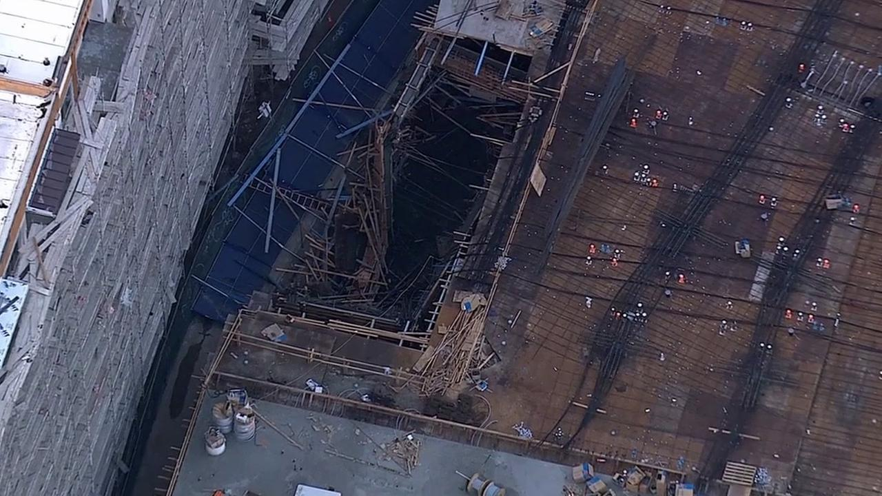 Los Angeles firefighters respond to a floor collapse in the 1000 block of S. Olive Street in downtown Los Angeles Wednesday, May 20, 2015.