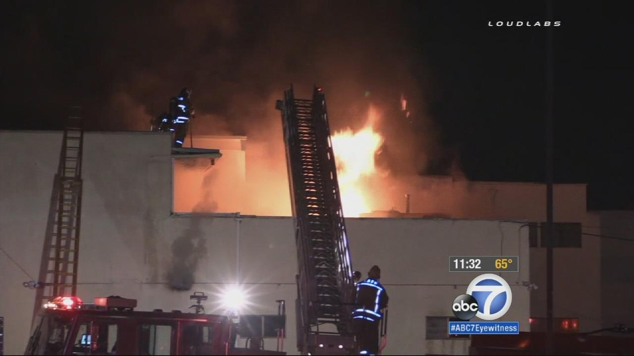 Firefighters are shown battling a building fire in West Hollywood on Thursday, May 21, 2015.