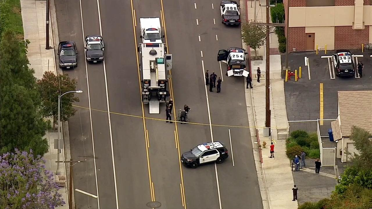 Los Angeles police investigate a suspicious package near Devonshire Street and Canoga Avenue in Chatsworth on Friday, May 22, 2015.