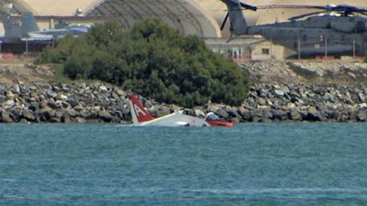 A pilot safely ejected into San Diego Bay on Friday when a training jet went off the end of a runway at Naval Air Station North Island on Friday, May 22, 2015.