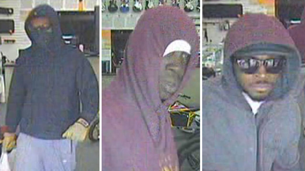 Three men suspected of robbing a pawn shop at gunpoint are shown in surveillance video on Sunday, May 24, 2015.