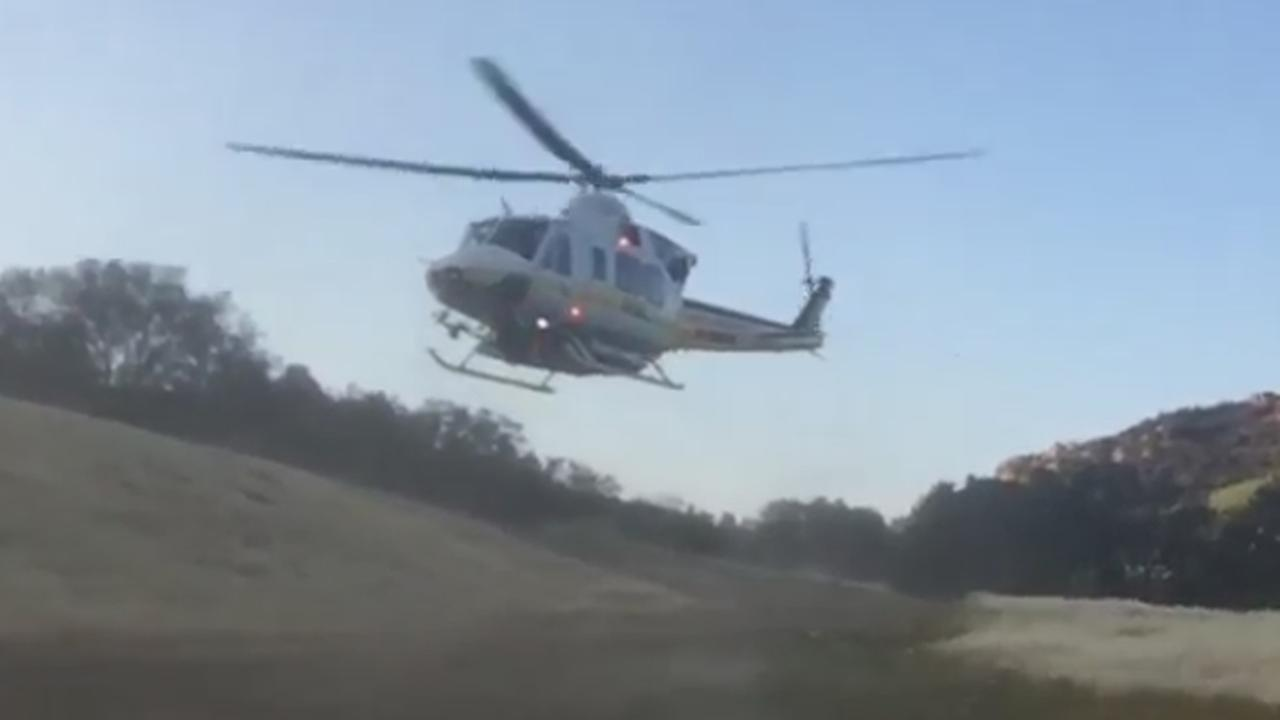 A helicopter airlifts two Los Angeles County sheriffs deputies injured in a rollover crash in Malibu on Sunday, May 24, 2015.