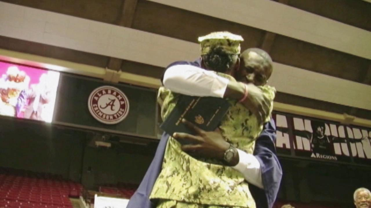 A mom, who had been deployed with the Army overseas, came home early to surprise her son, as he walked across the stage.