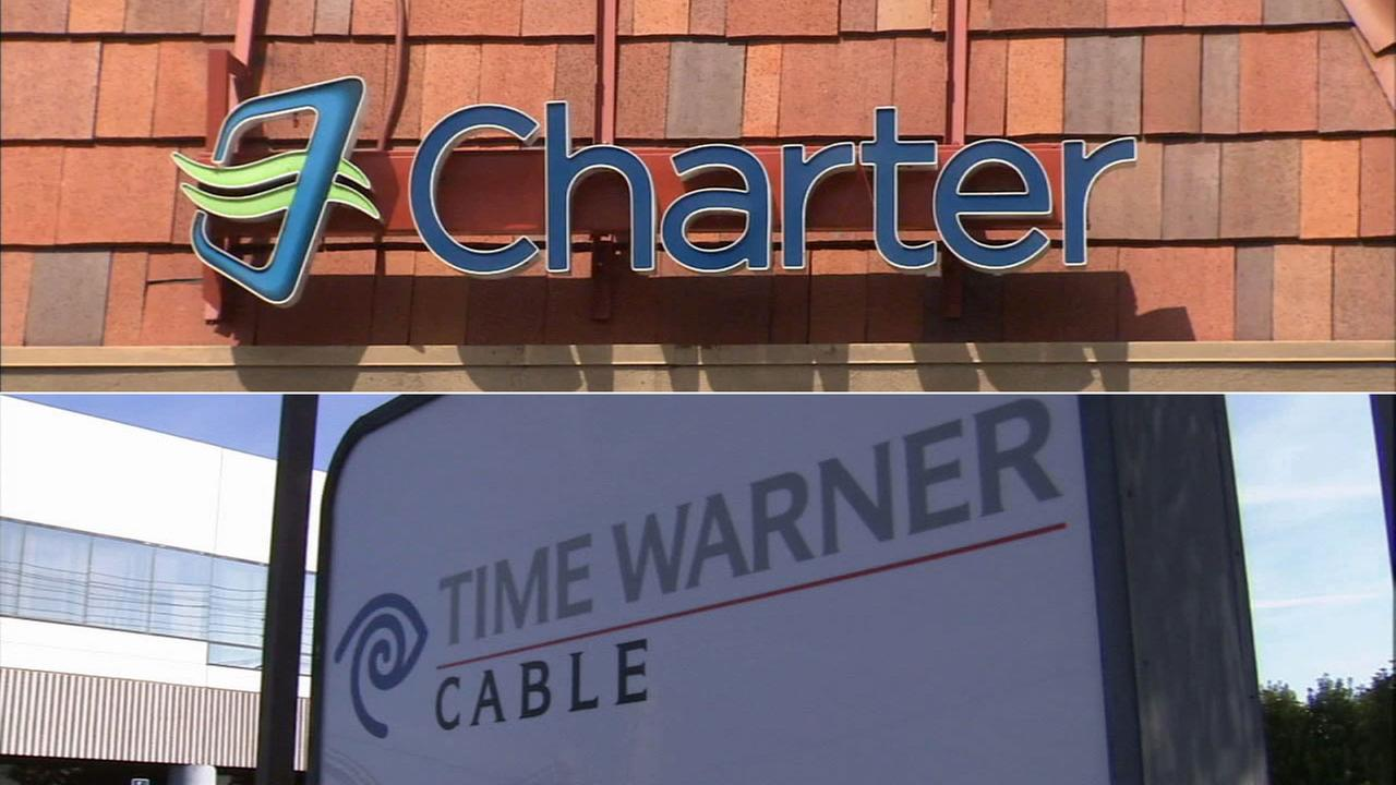 Signs for Charter Communications and Time Warner Cable are shown in these undated file photos.
