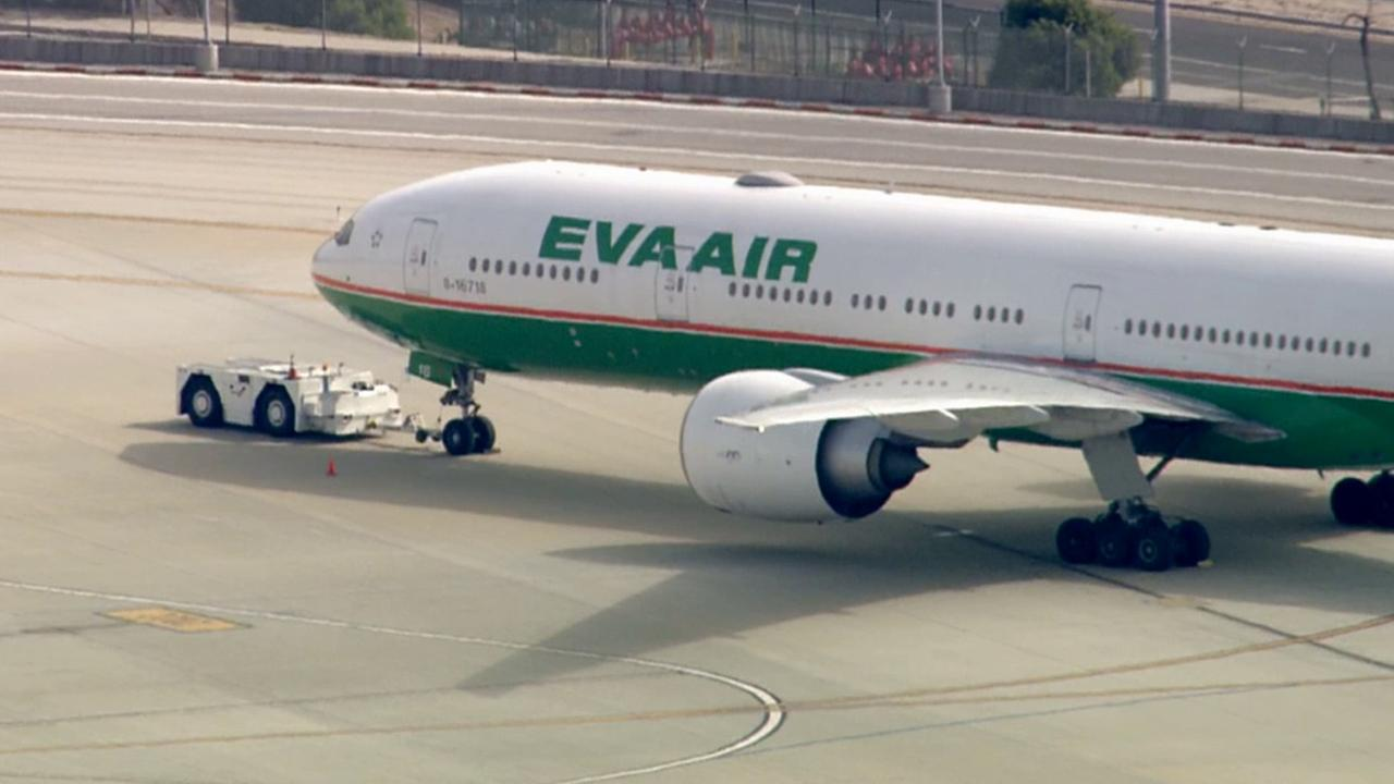 An EVA Air flight lands safely at Los Angeles International Airport on Tuesday, May 26, 2015.