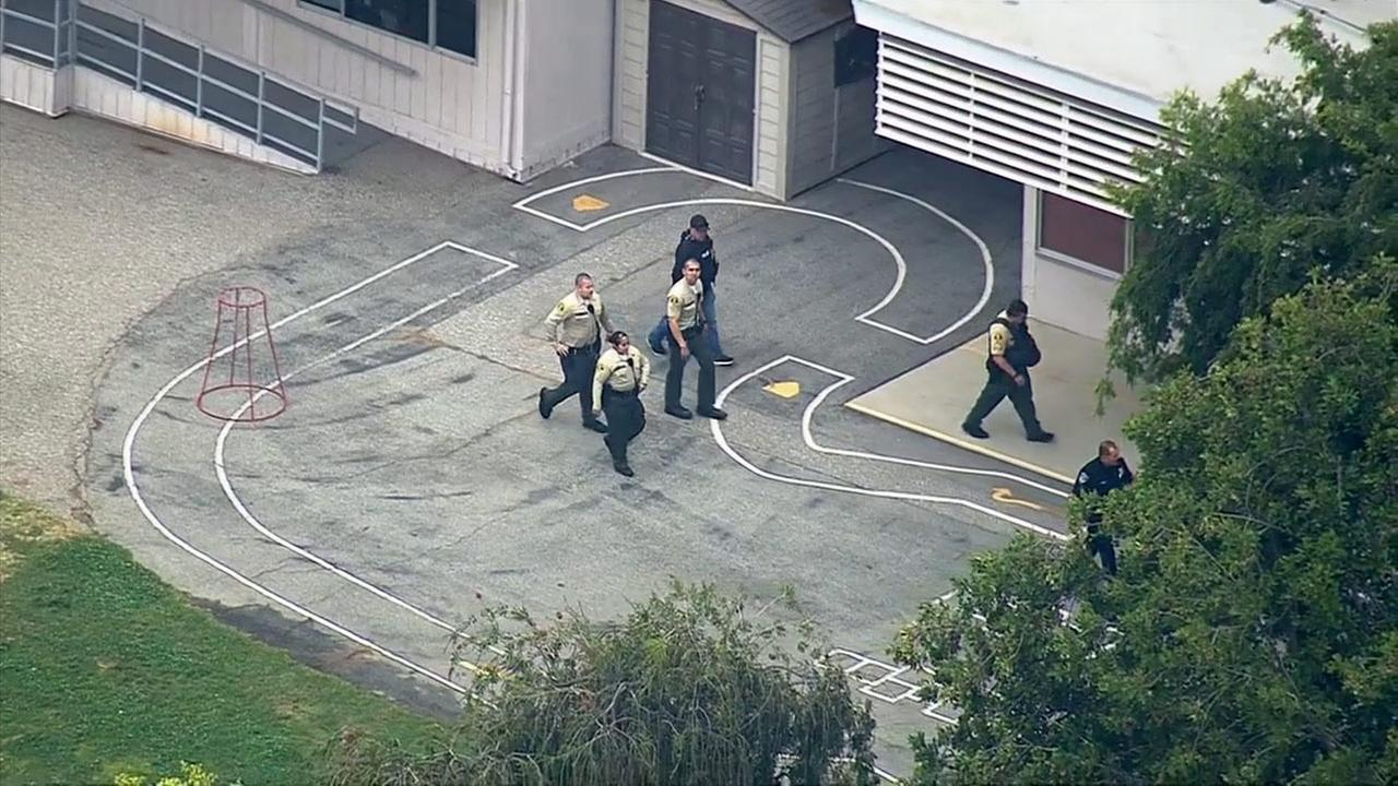 Los Angeles County sheriffs deputies investigate a threat against Rivera Middle School on Wednesday, May 27, 2015.