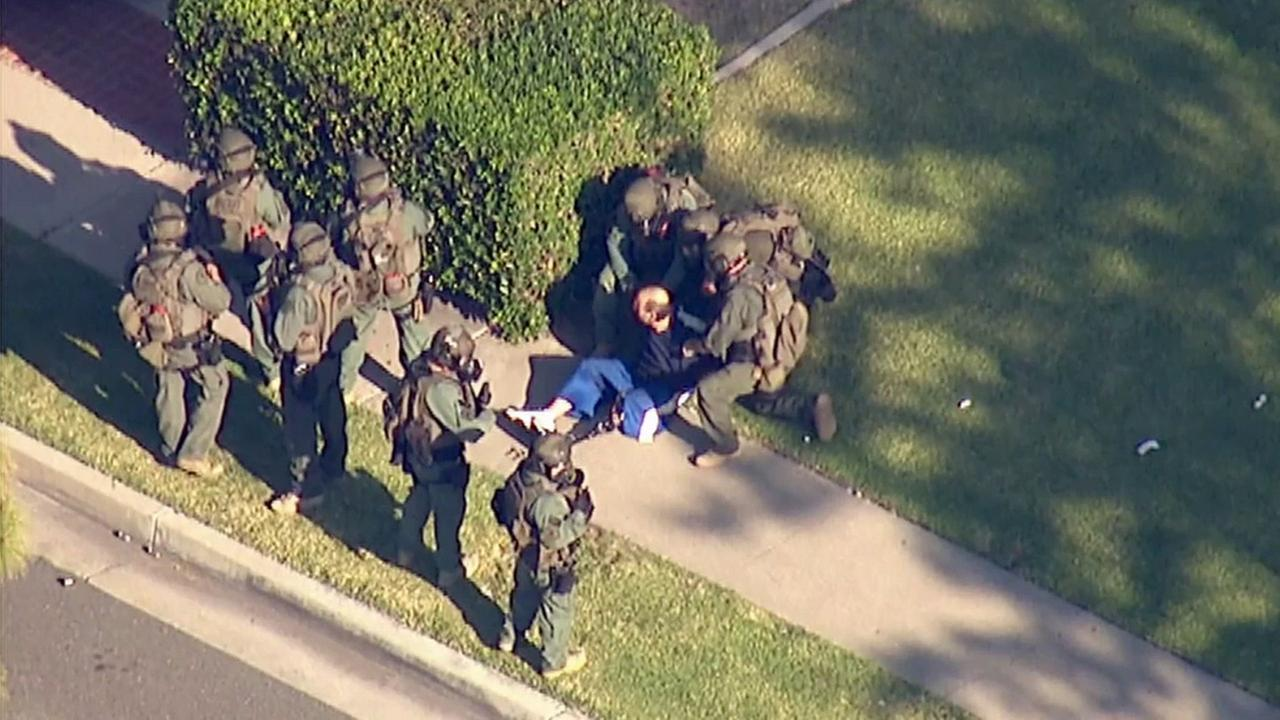 A man is detained by SWAT after an hours-long barricade in La Mirada on Wednesday, May 27, 2015.
