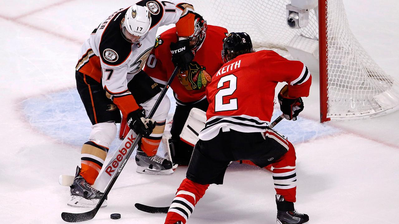 Anaheim Ducks center Ryan Kesler (17) tries to shoot on Chicago Blackhawks goalie Corey Crawford as defenseman Duncan Keith (2) defends during the first period in Game 6.