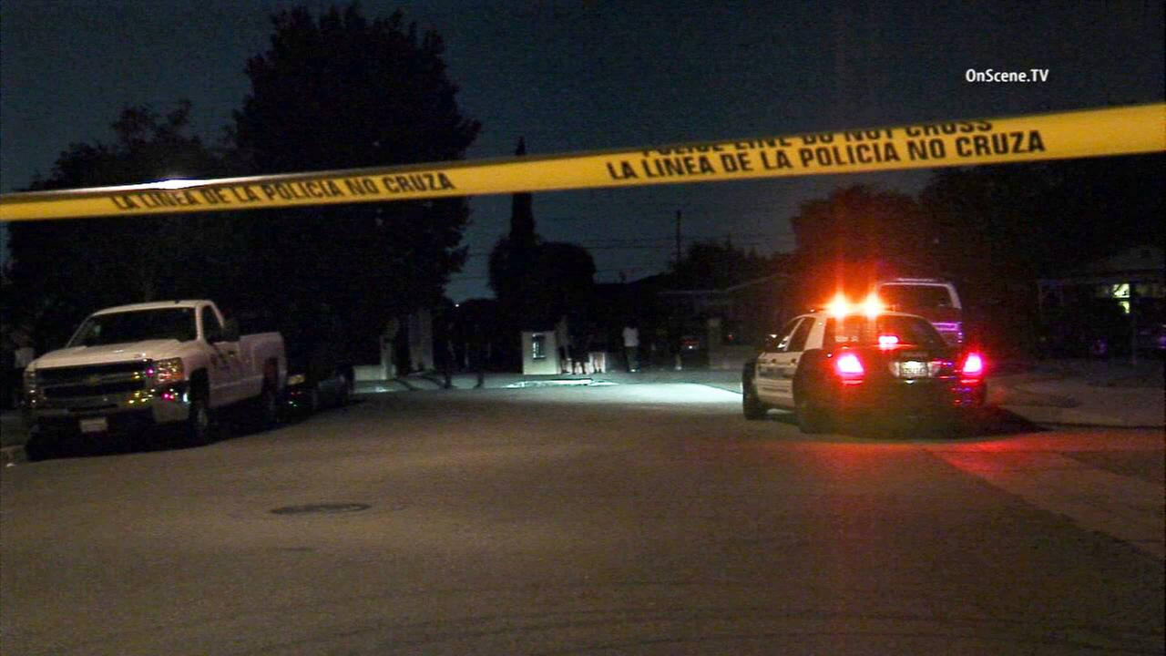 Crime tape ropes off the scene of a shooting in the 500 block of East Duell Street in Azusa on Wednesday, May 27, 2015.
