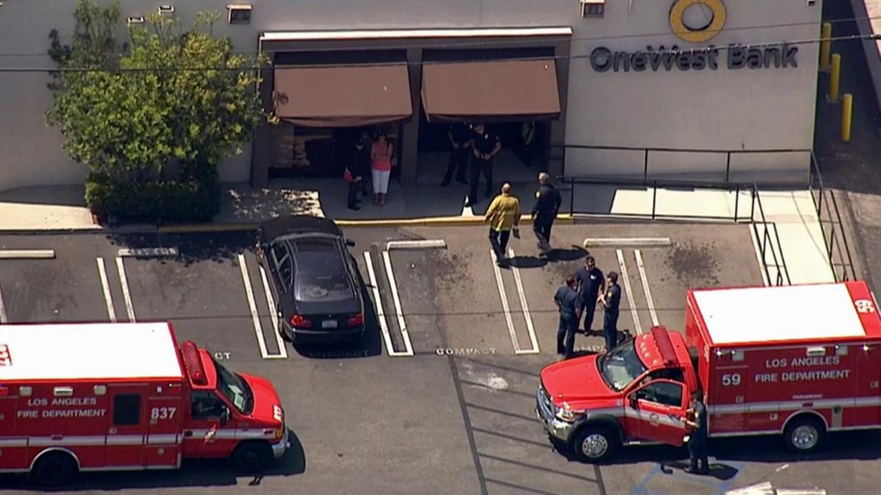 Los Angeles police and firefighters respond to a bank robbery at OneWest Bank in the 11300 block of National Boulevard in West Los Angeles Thursday, May 28, 2015.