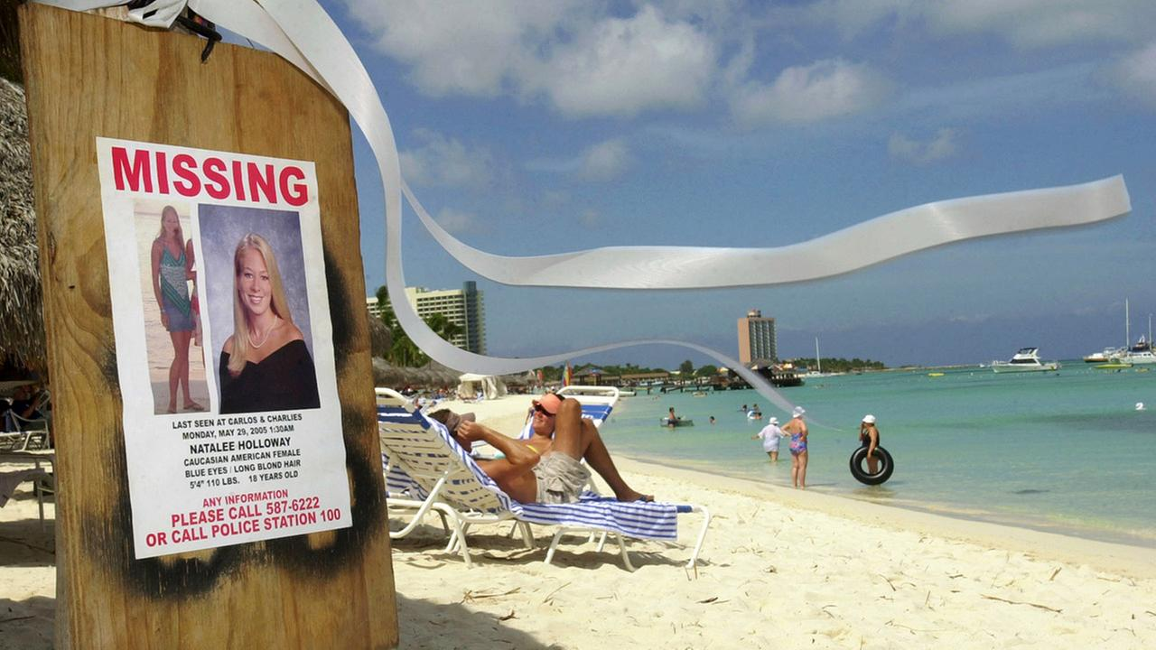 This June 10, 2005 file photo shows a missing poster for Natalee Holloway, a high school graduate of Alabama who disappeared while on a graduation trip to Aruba on May 30, 2005.