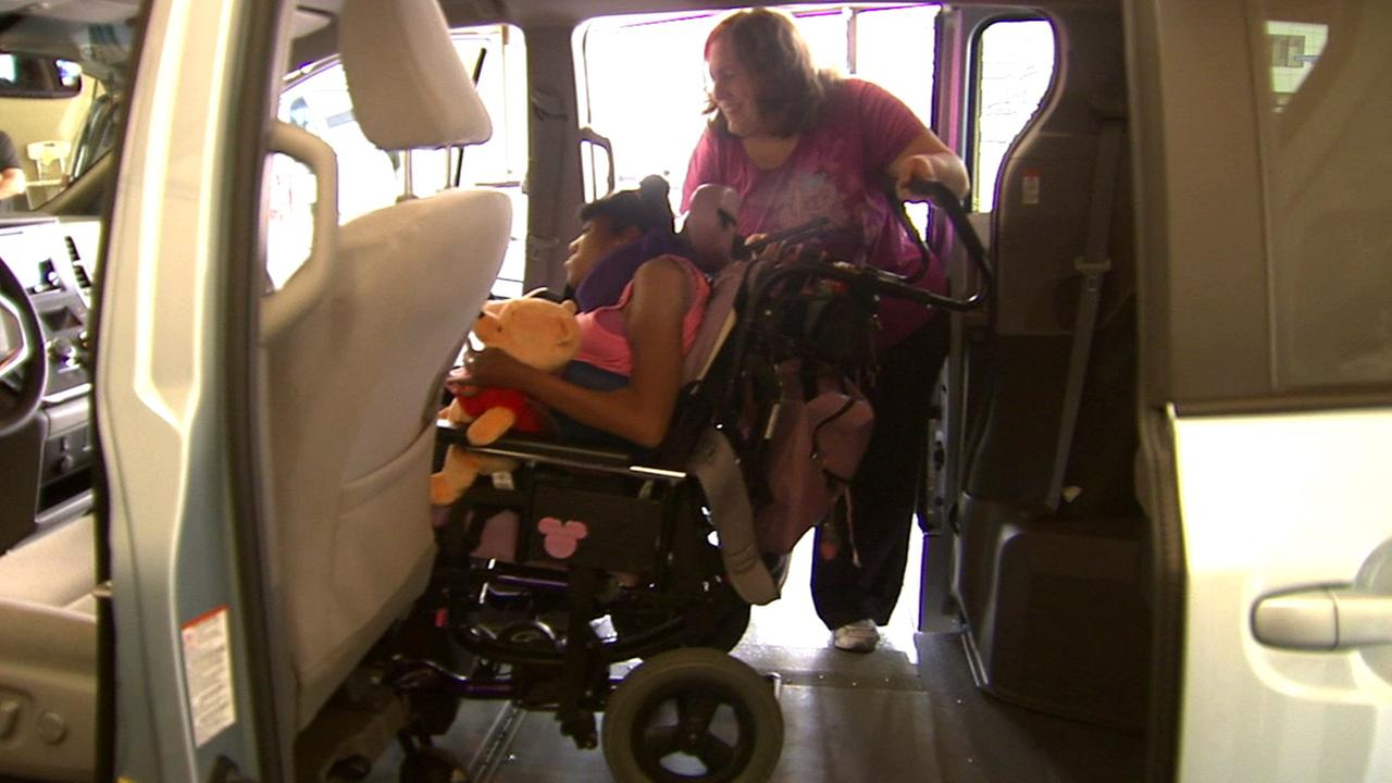 Dayna Bennett and her daughter Shellie Joy enjoy their new wheelchair lift van on Thursday, May 28, 2015.