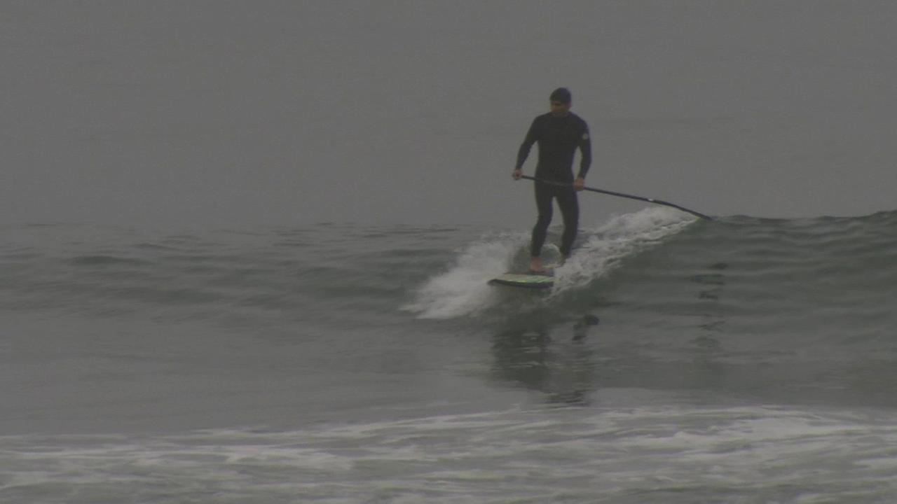 Surfers and swimmers were back in the water at South Bay beaches Saturday, May 30, 2015 after crews collected about 40 cubic yards of an oil substance.
