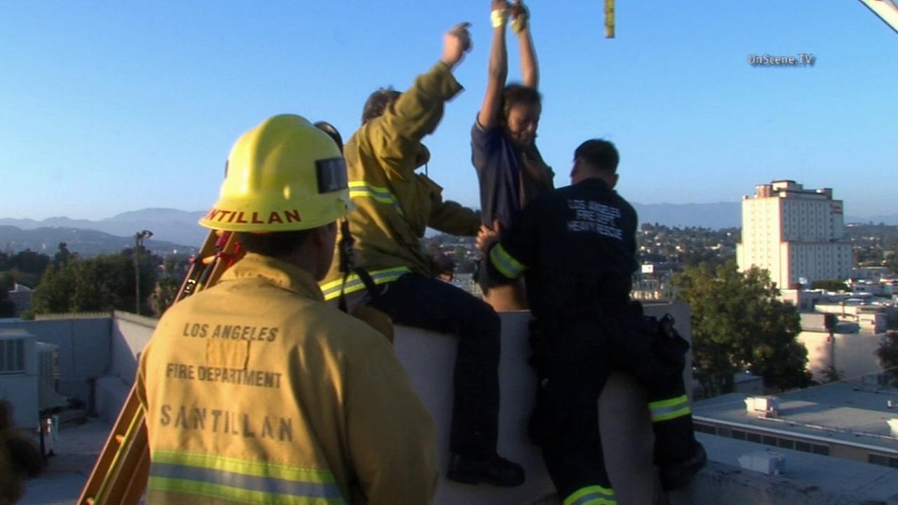 Firefighters rescue a woman from a chimney vent at Virgil Middle School in Koreatown on Saturday, May 30, 2015.