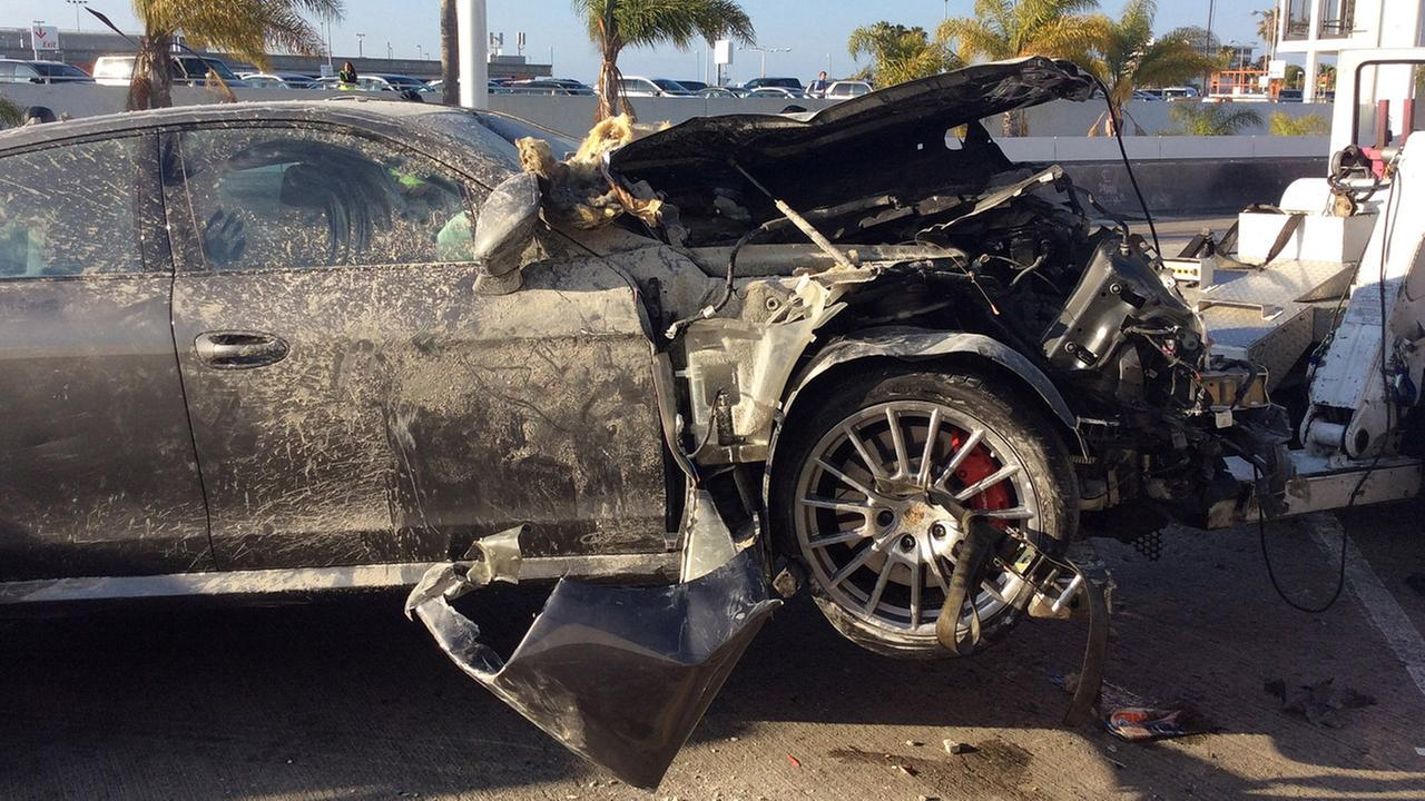 The front end of a sedan is crushed after the driver crashed the car into a stucco wall at Terminal 7 at Los Angeles International Airport on Sunday, May 31, 2015.