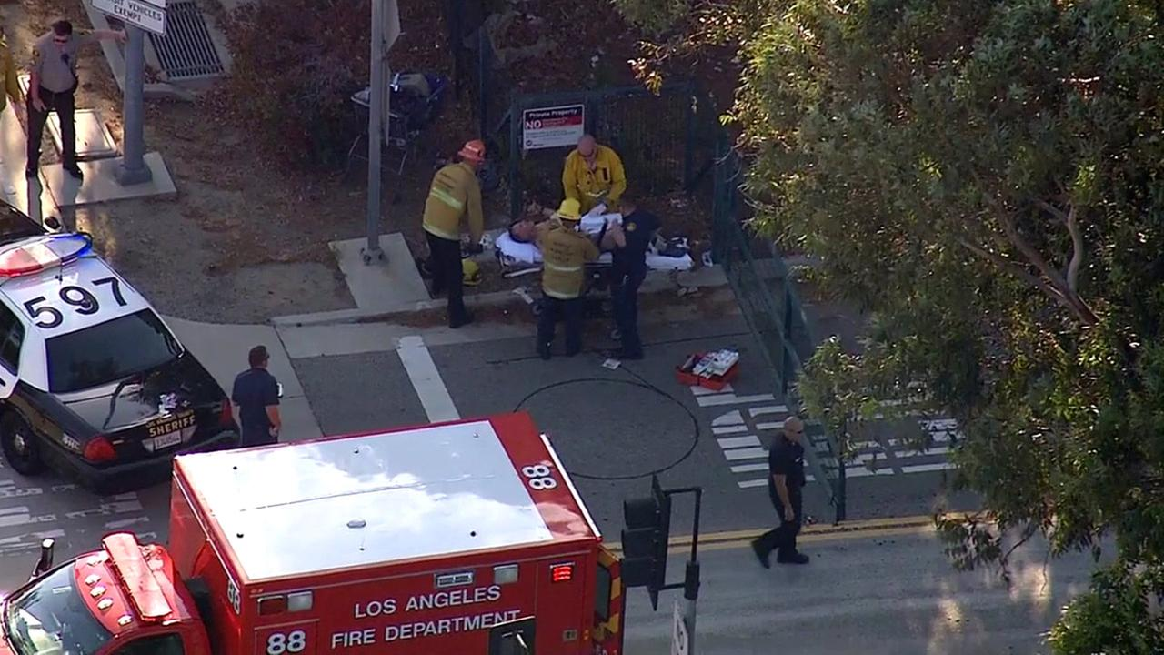 Los Angeles firefighters transport a man injured in a deputy-involved shooting in North Hills on Monday, June 1, 2015.