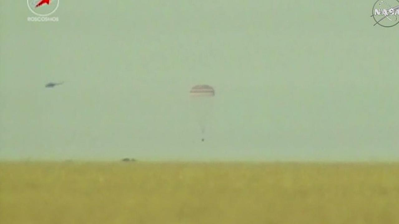The Soyuz spacecraft carrying NASA astronaut Terry Virts, European astronaut Samantha Cristoforetti and Russian cosmonaut Anton Shkaplerov is seen just a few seconds from landing in the steppe of Kazakhstan.