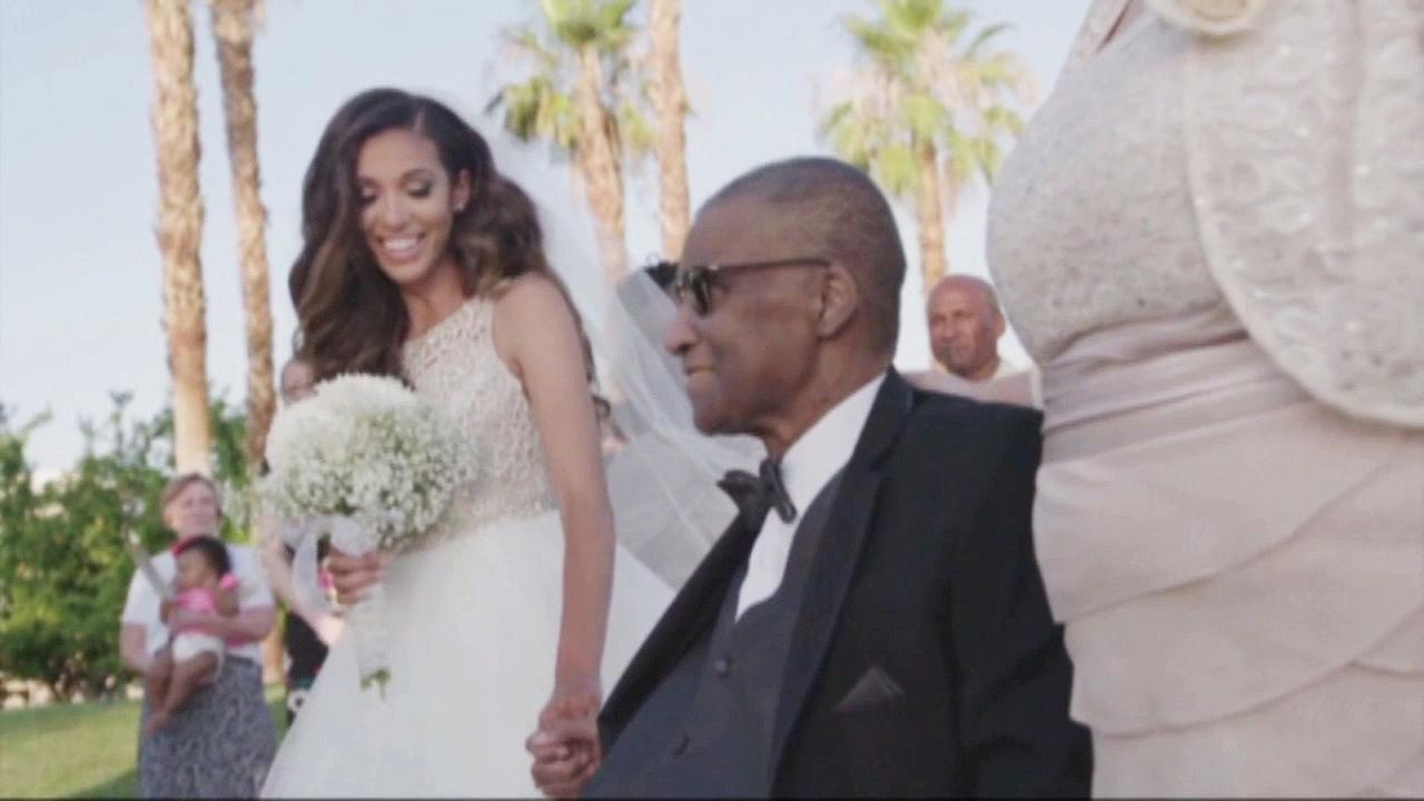 Andre Pearson and his daughter Alexandra hold hands at Alexandras wedding ceremony in Indio, California.