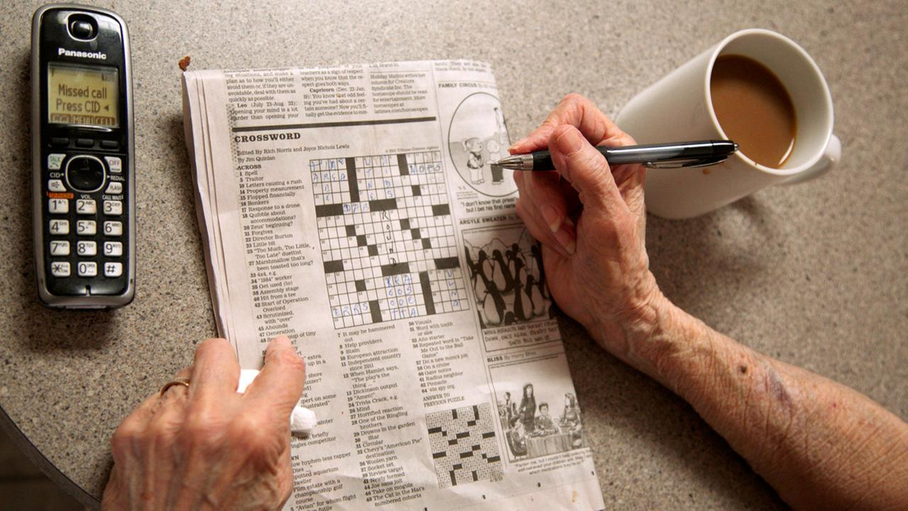 In this photo taken April 3, 2015, Eleanor Blum, 88, solves crossword puzzles, as she lets her phone go unanswered at her in the Sherman Oaks area of Los Angeles.