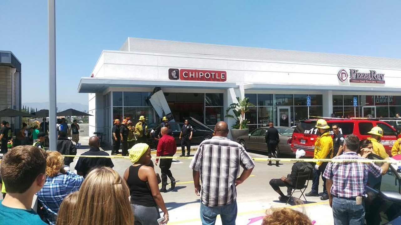Firefighters respond to a crash at a Chipotle in the 4500 block of Pico Boulevard in the Mid-City area of Los Angeles Friday, June 19, 2015.