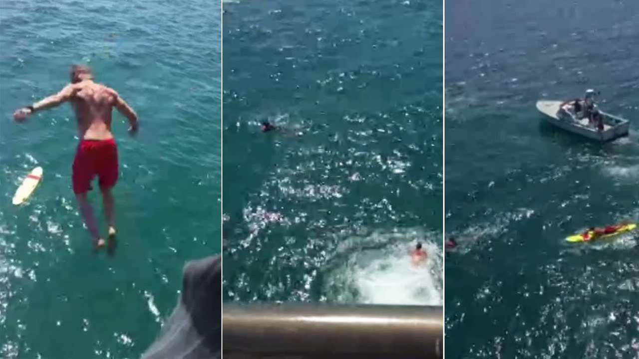 A lifeguard jumped off the Huntington Beach pier Sunday, June 21, 2015 to save an alleged drunk swimmer who refused to get out of the water.