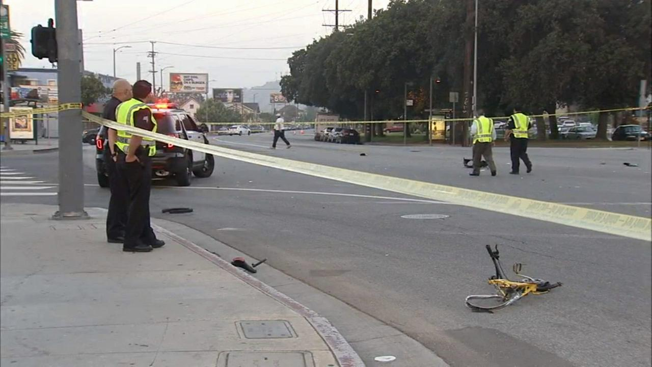 Law enforcement officials are shown at the scene of a fatal hit-and-run crash that killed a bicyclist in Highland Park on Friday, June 26, 2015.