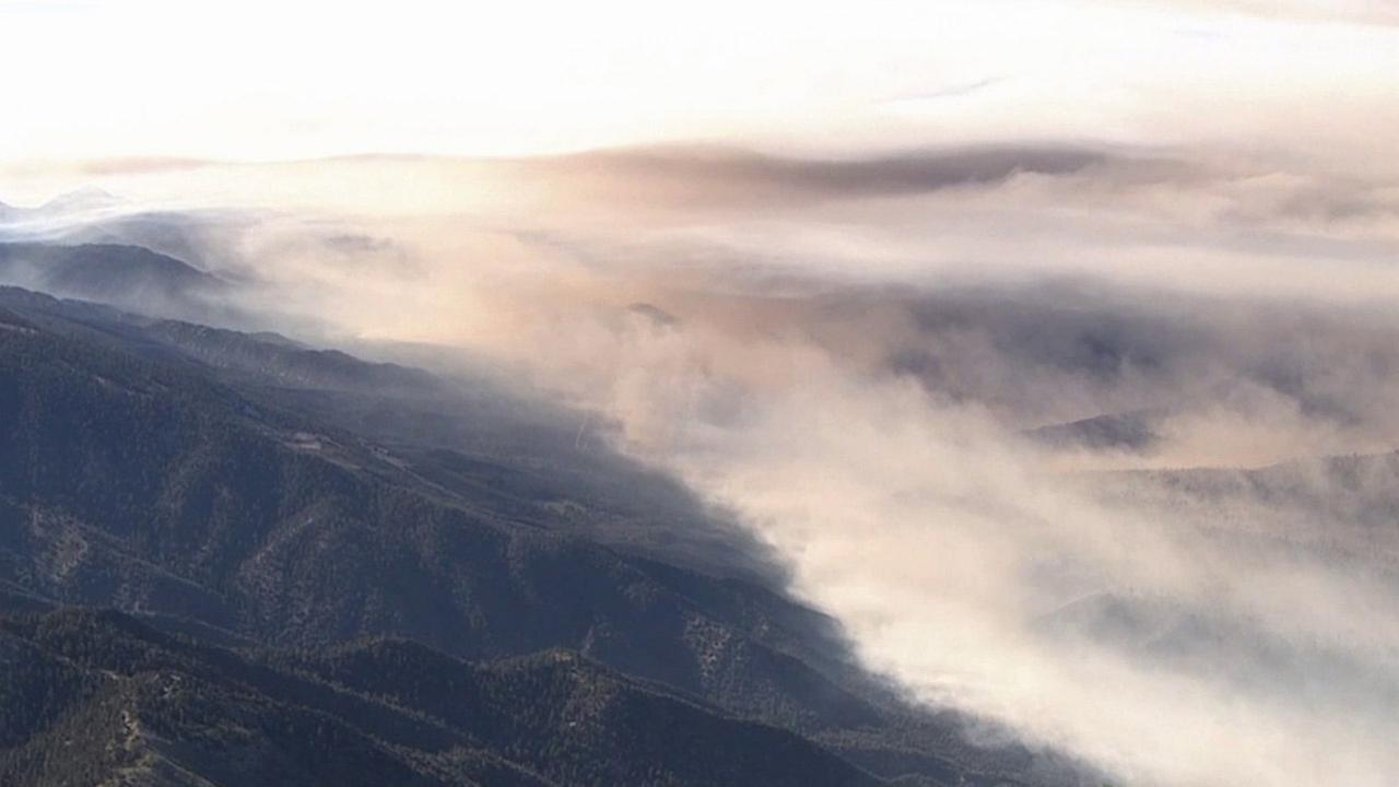 Thick smoke from the Lake Fire can be seen hovering over the San Bernardino Mountains in this undated photo.