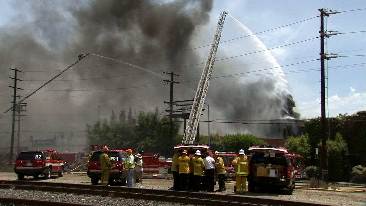 Firefighters work to put out a commercial building fire in El Sereno on Sunday, June 28, 2015.