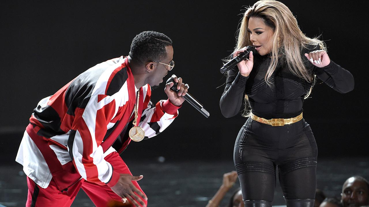 Sean Diddy Combs, left, and Lil Kim perform at the BET Awards at the Microsoft Theater on Sunday, June 28, 2015, in Los Angeles.