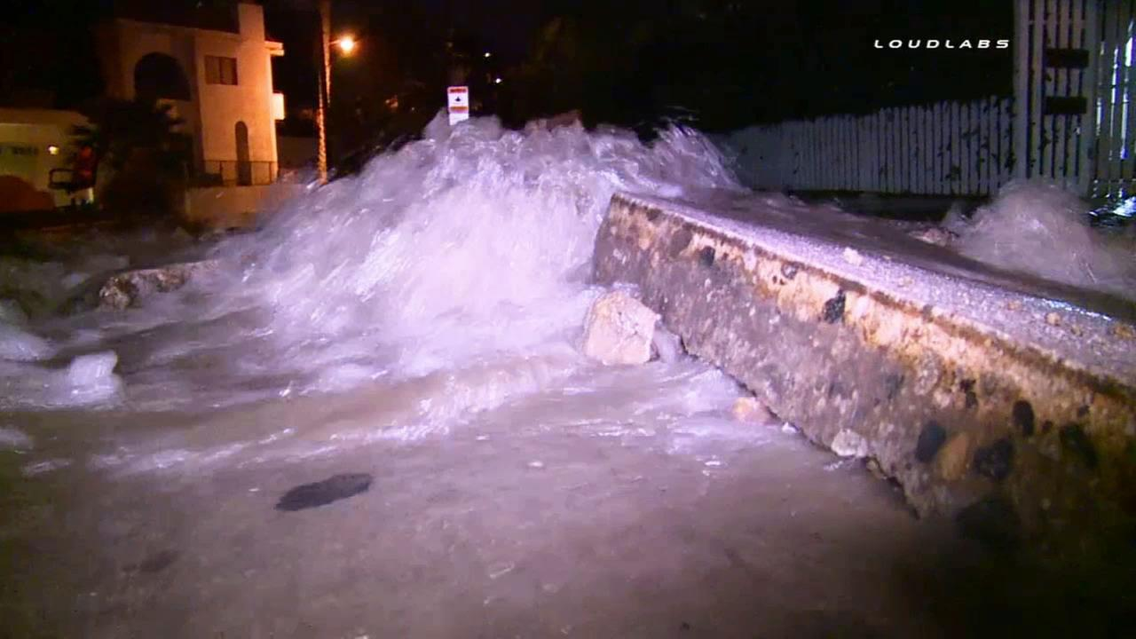A large water main break sent water gushing through the streets and even buckled some roads in the Hollywood Hills on Monday, June 29, 2015.